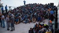 African migrants, who were rescued by the Libyan coastguard in the Mediterranean off the Libyan coast, arrive at a naval base in Tripoli, Libya, on 26 May 2017