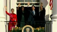 The Obamas and the Trudeaus wave from the Truman Balcony of the White House