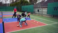 Children doing tennis drills