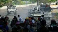 Security forces clash with protesters in Caracas, Venezuela