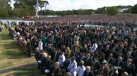Crowds gather at the memorial service