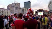 Fans watch match on big screen