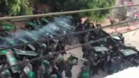 Screen shot from video posted online appearing to show clashes between police and the villagers of Wukan. China