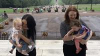 Two mums walking up Stormont steps