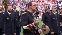 A French band play Oasis's Don't Look Back In Anger ahead of kick-off