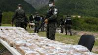 A Colombian cocaine haul being watched over by police in Tegucigalpa July 11 2017