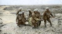 Colourised image of stretcher bearers in the mud of Passchendaele in 1917