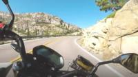 Motorbike rider's point of view of open mountain road