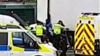 Migrants being arrested at Portsmouth Port