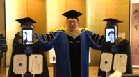 Students graduating at Tokyo's Business Breakthrough University via telepresence robots