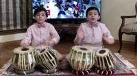 Two drum playing brothers