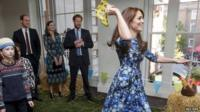 Kate, Duchess of Cambridge takes part in welly wanging