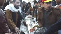 Casualty being carried from blast scene