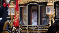 The Queen in a carriage