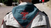 Child wearing a Boy Scouts uniform