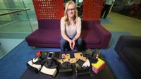Kate Russell with a selection of VR goggles