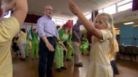 Young and old dance together
