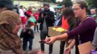 Nickelsdorf locals hand out food and drink to migrants