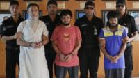 Suspected members of a banned Islamic militant outfit Ansarullah Bangla Team, Touhidur Rahman, second left, Sadek Ali, center and Aminul Mollick, second right