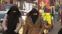 Two women walking along a Birmingham street