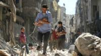 Children are taken out of rubble in Aleppo