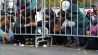 Migrants wait at Sentilj on the Slovenian Austrian border