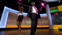Strictly star Oti Mabuse shows Focus on Africa's Peter Okwoche how to cha-cha-cha