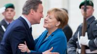 David Cameron greets Angela Merkel