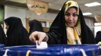Iranian woman casts vote in Qom (file photo)