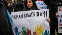 Woman holding slogan