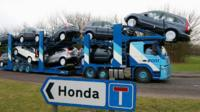 A transporter loaded with Honda cars leaves the Swindon factory on January 30, 2009.