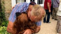 Philip Whaites hugging his granddaughter