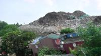 Rubbish dump and a destroyed home