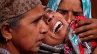 """Woman consoled in Kashmir""""s Pulwama district"""