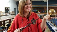 Victoria Maclean holding an item of Harry Potter merchandise