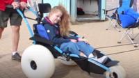 girl in beach wheelchair