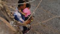 A man and child in an enclosure, El Paso