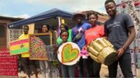 Makafui Awuku with team and recycled plastic goods