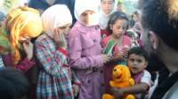Syrian children holding toys
