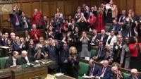 MPs clapping and cheering in Commons