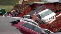 Cars swallowed up in hole