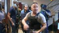 TV image taken from Mali TV ORTM, shows security officersinside the Radisson Blu Hotel in Bamako,