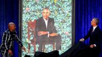 Barack Obama (R) and artist Kehinde Wiley unveil his portrait during a ceremony at the Smithsonian's National Portrait Gallery