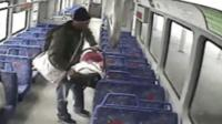 Man with baby on train