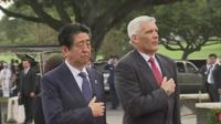 Japanese PM Shinzo Abe and director of the National Memorial of the Pacific, James Horton.