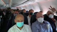 Masked passengers on a plane