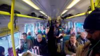 Inside a packed commuter train