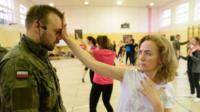 Women take part in a self-defence training class