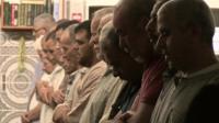 Men at prayers