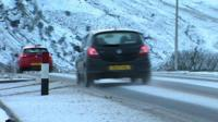 Traffic passing through snow covered roads